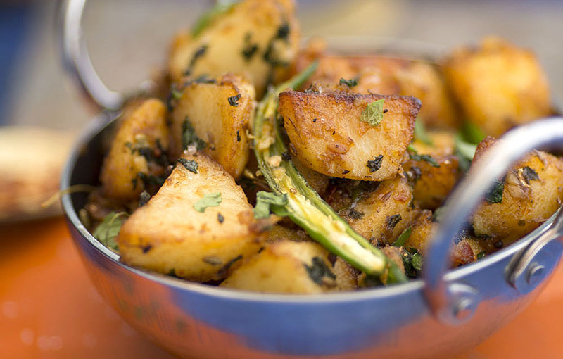 Potatoes Cooked in Mint and Tamarind recipe image